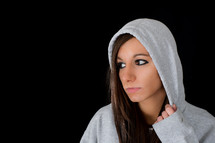 Distressed young woman in a hoodie.