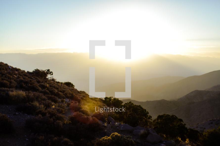 Sunburst in mountains