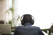 a man listening to headphones