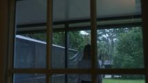 a woman watching the falling rain