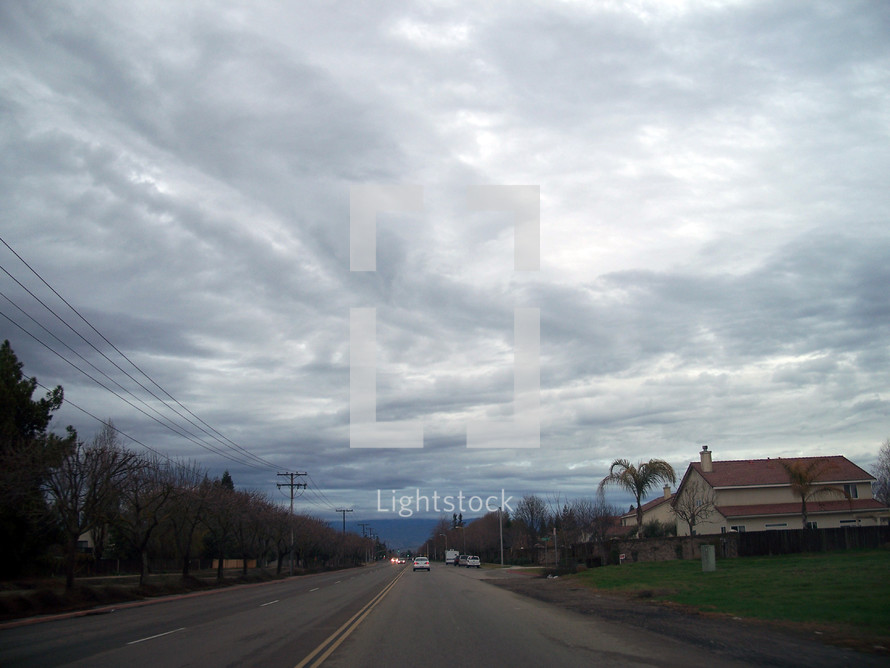 The Coming storm clouds roll in around a small California town somewhere near Visalia California looking like something from a movie.