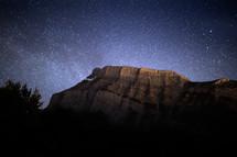 mountain peak under a starry sky
