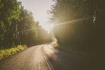 rural road under sunlight