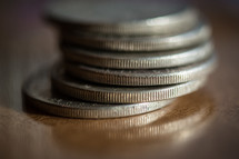 A stack of silver  coins.