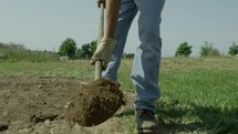 digging with a shovel to break ground