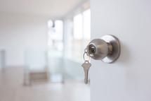 key in a door of an empty house