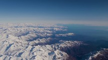 aerial view over snow capped mountains - Alps