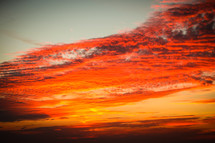 red clouds in the sky at sunset