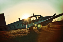single engine airplane in a field