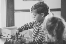 children playing with board games