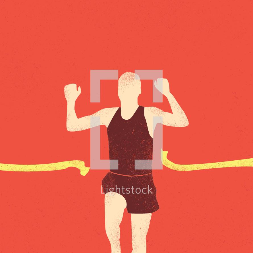 man running through the finish line.