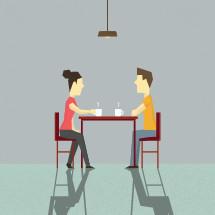 A couple conversing over coffee.
