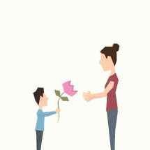child giving a flower to his mother