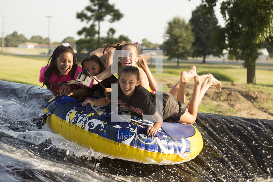 summer fun with an inner tube and slip and slide