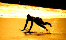 man skim boarding