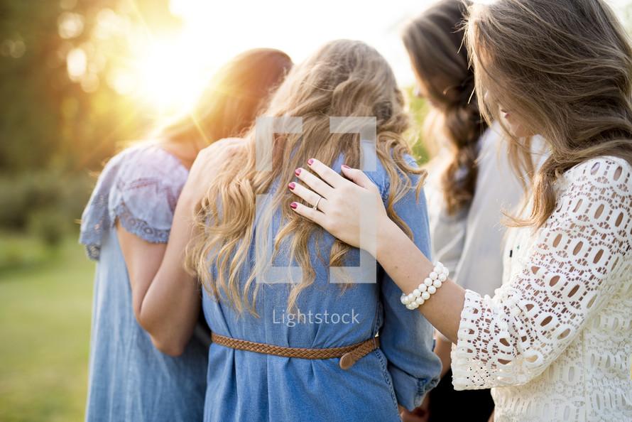 women in a prayer circle