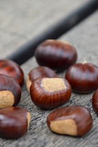 chestnuts on wooden planks