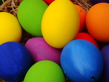Multicolored Easter eggs in a basket.