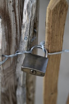 Padlock on a wooden fence. 