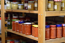 jars of preserved food on pantry shelfs