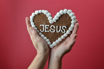 heart shaped cookie with the word Jesus