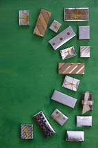 many little presents building a frame on a green wooden background