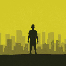 silhouette of a man standing in front of a city