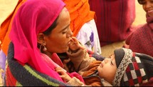 A mother holding her child in India