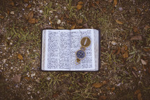 compass on the pages of a Bible