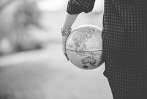 a woman holding a globe