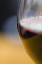 Wine, Communion Element; wine glass with edge in focus.
