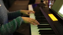 playing a piano during a worship service