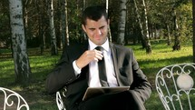 businessman using a tablet outdoors