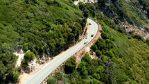 Flying Across a Mountain Road with Cars