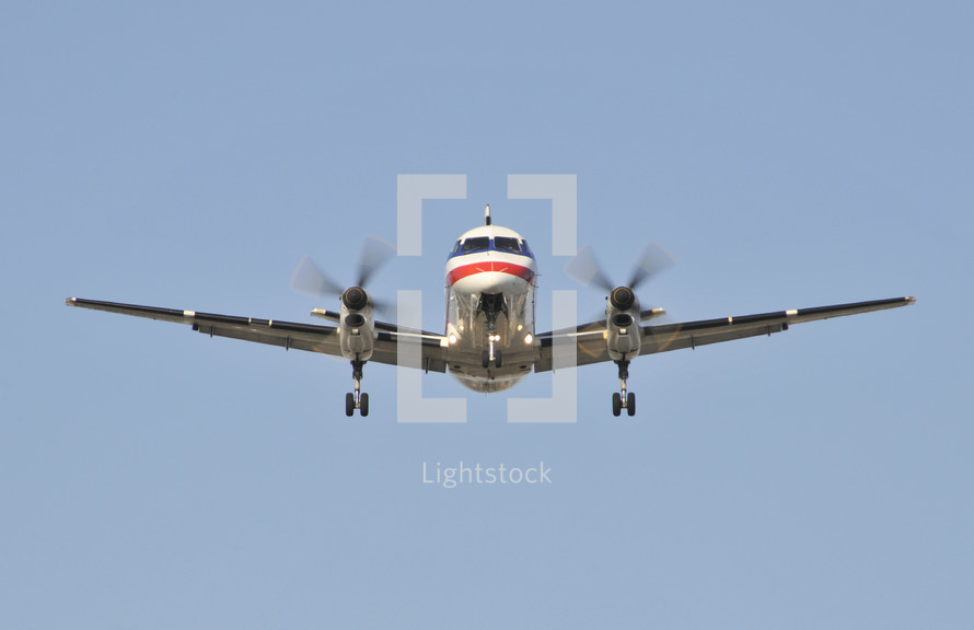 Commercial airplane in flight. Turbo prop, American Airlines.