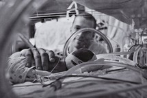 Father looking at premature baby