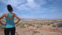 a woman viewing a desert oasis