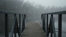 dock over a foggy lake