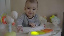 infant in a baby walker