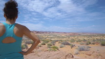 woman viewing a desert oasis