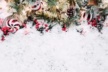 Christmas border on white snow