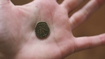 a coin in a hand