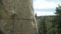 a man climbing a mountainside