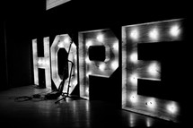 hope lighted sign on stage