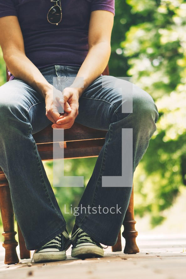 A man sitting in a chair.