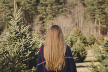 woman in a Christmas tree lot