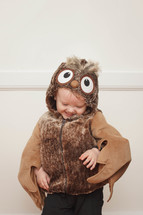toddler boy in a owl Halloween costume