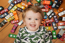 boy child with toy cars