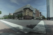 time-lapse of a traffic in front of a building in a city