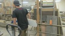 man walking through his workshop